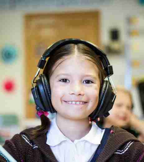 Smiling child with headphones on