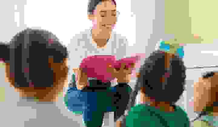 Woman reading book in school