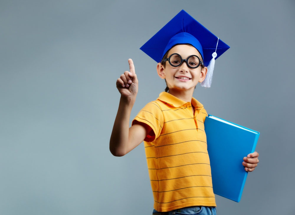 student with glasses and graduation cap